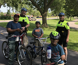Residents with bike patrol during the summer