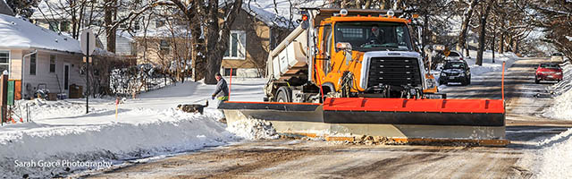 City truck plowing road