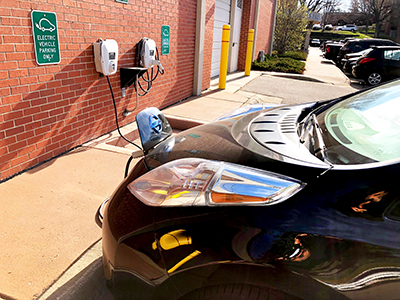 electric vehicle plugged in at charging station