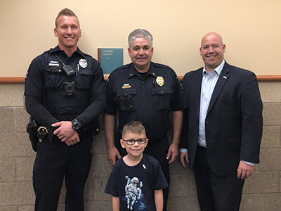 2019 Mayor for a Day Danny with Mayor Spano, Police Chief Harcey and a police officer